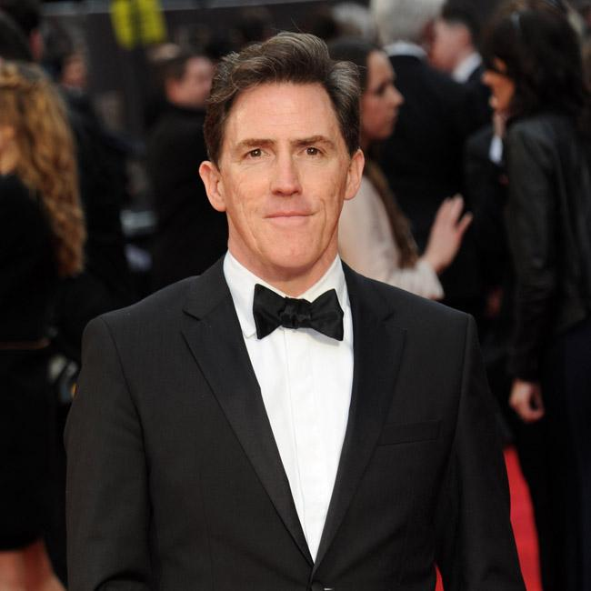 Rob Brydon took swimming lessons from a neighbor